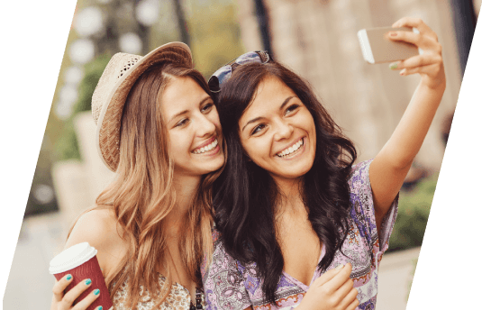 two women taking a picture together
