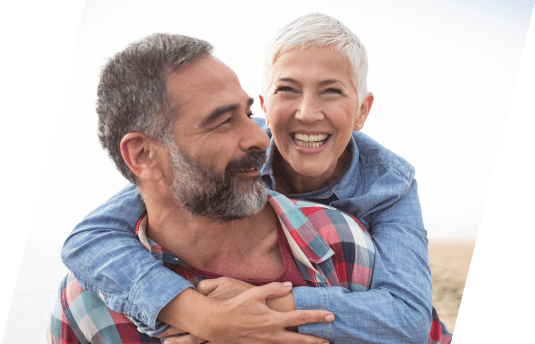 Woman with dentures smiling with husband