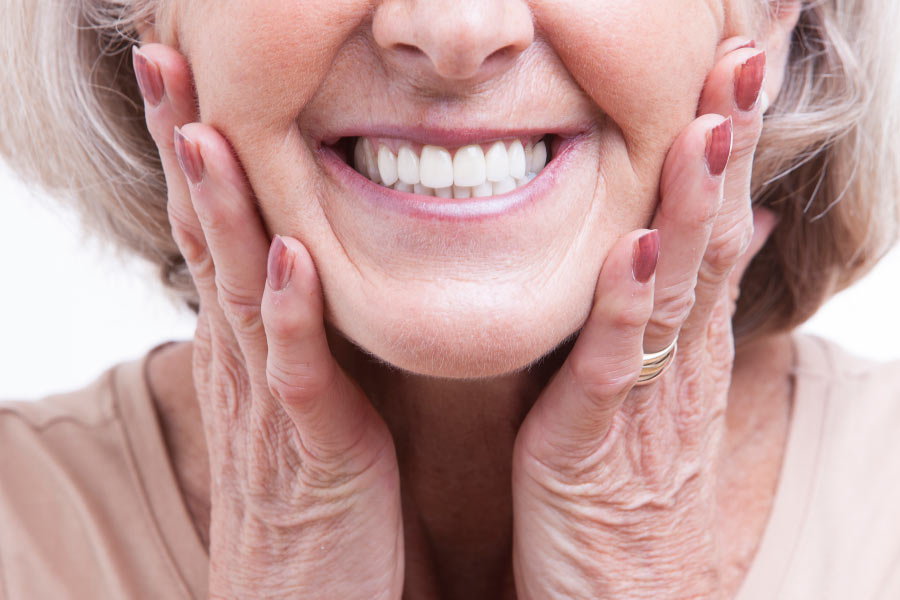 Close up of a mature woman smiling to show her beautiful new veneers.